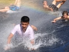 Yr 9 Student Jeff Afan enjoys the waterslide during HOT first week of the hostel.