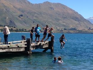 Student Jumping Off Wanaka Jetty. Waitangi Day.